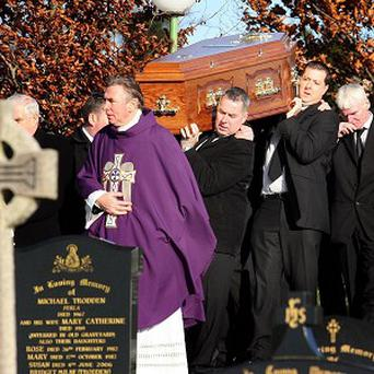 Family members carry the coffin of Thomas O'Hare at St Patrick's Church, Ballymacnab, Co Armagh