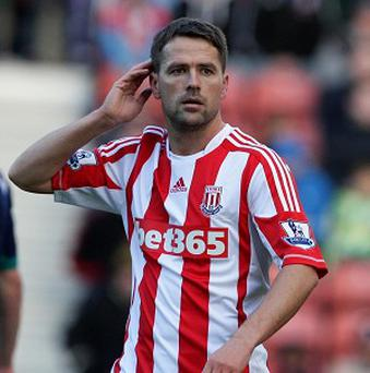 Tony Pulis hopes to keep Michael Owen, pictured, for the rest of the season
