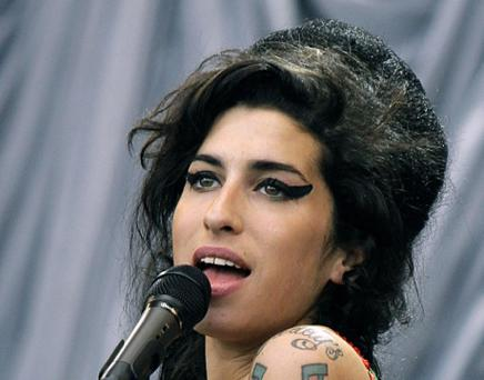 File photo dated 22/06/07 of Amy Winehouse. The inquest into the death of singer Amy Winehouse is due to be reheard today. PRESS ASSOCIATION Photo. Issue date: Tuesday January 8, 2013. The Back To Black star was found dead at her north London home in July 2011, aged 27. The move comes after an investigation found Suzanne Greenaway, who oversaw the inquest into Winehouse's death, did not have the correct qualifications for the role. The new hearing is due to take place today at St Pancras Coroner's Court in London. Ms Greenaway recorded a verdict of misadventure at the original hearing in October 2011. See PA story INQUEST Winehouse. Photo credit should read: Yui Mok/PA Wire