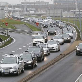 Striking taxi drivers block access at Orly's airport, south of Paris (AP)