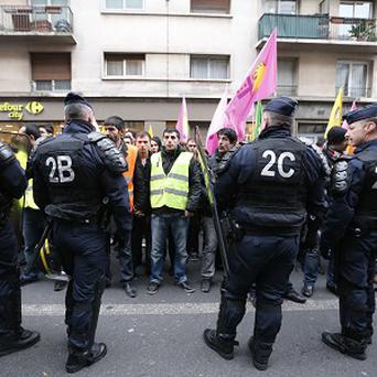 Kurdish activists gather outside a building where three Kurdish women were shot dead in Paris (AP)