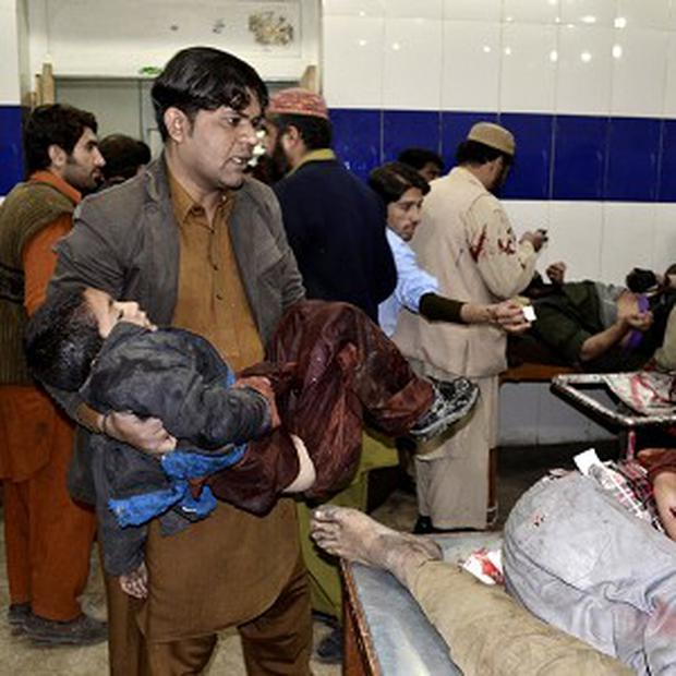 A Pakistani child who was injured in a bomb blast is taken to hospital for treatment in Quetta (AP)