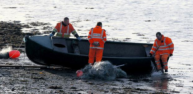Members of the coastguard retrieve the fishing boat in which John Flynn lost his life, at Saleens, Tramore, Co Waterford