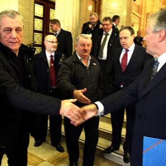 UDA Leader Jackie McDonald shakes hands with First Minister Peter Robinson at Stormont after the first meeting of the Ulster Unionist Forum