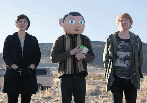 Maggie Gyllenhaal, Michael Fassbender (centre) and Domhnall Gleeson on the set of 'Frank'