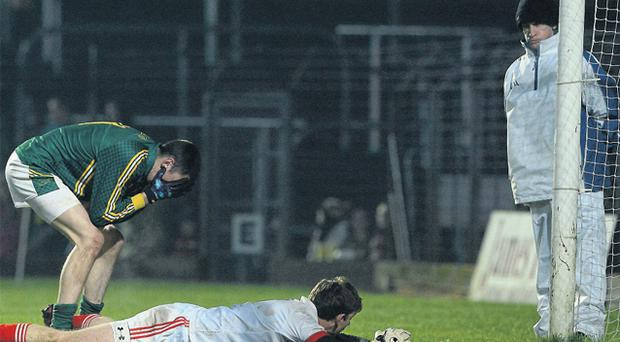 Louth goalkeeper Neil Gallagher checks that the ball has gone wide as Meath's Damien Carroll reacts after missing a penalty during the Bórd na Móna O'Byrne Cup match at Páirc Táilteann, Navan