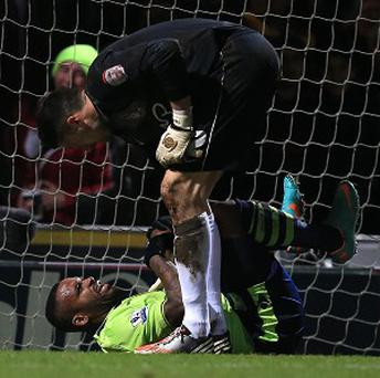 Darren Bent, bottom, will be sidelined for 10 days with the knee injury he suffered at Bradford