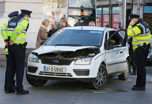 Gardai at the scene of an accident involving a Luas and a car at the junction of O'Connell Street/Abbey Street