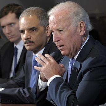 Vice President Joe Biden, with Attorney General Eric Holder, on his left, speaks during a meeting with victim's groups and gun safety organisations (AP)