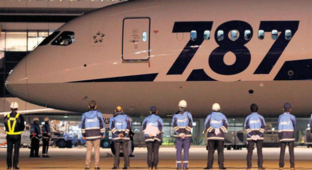 Staff send off All Nippon Airways' Boeing 787 Dreamliner before take-off at New Tokyo international airport .