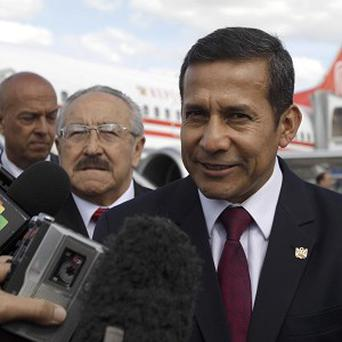 Peru's President Ollanta Humala speaks with journalists after arriving in Havana, Cuba, to visit Hugo Chavez (AP)