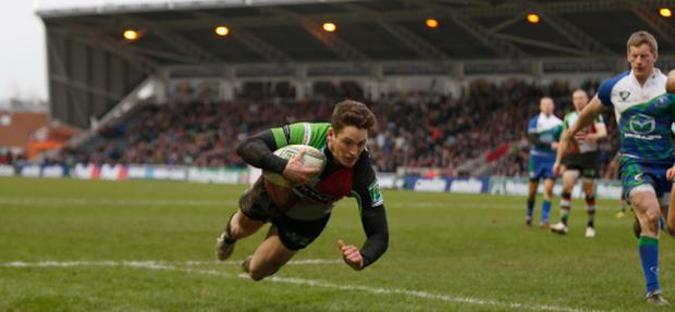 LONDON, ENGLAND - JANUARY 12: Tom Williams of Quins scores his second try during the Heineken Cup match between Harlequins and Connacht Rugby at Twickenham Stoop on January 12, 2013 in London, England. (Photo by Tom Shaw/Getty Images)