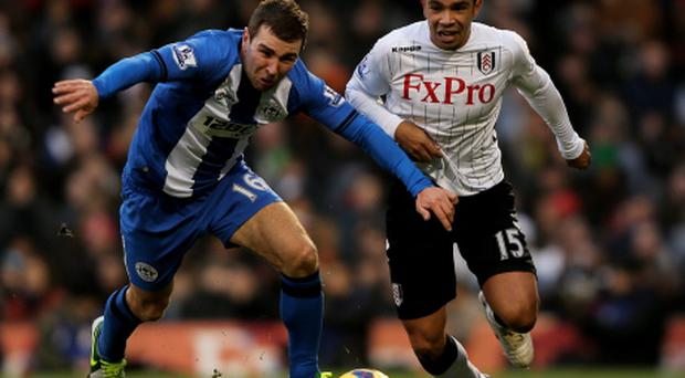 James McArthur of Wigan (l) and Kieran Richardson of Fulham compete at Craven Cottage. Photo: Getty