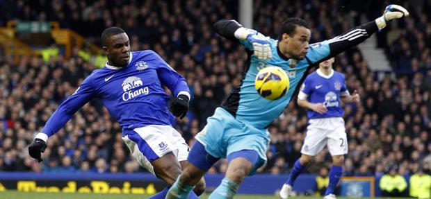 Everton's Victor Anichebe (left) in action with Swansea City goalkeeper Michel Vorm during the Barclays Premier League match at Goodison Park, Liverpool. PRESS ASSOCATION Photo. Picture date: Saturday January 12, 2013. See PA story SOCCER Everton. Photo credit should read: Peter Byrne/PA Wire. RESTRICTIONS: Editorial use only. Maximum 45 images during a match. No video emulation or promotion as 'live'. No use in games, competitions, merchandise, betting or single club/player services. No use with unofficial audio, video, data, fixtures or club/league logos.