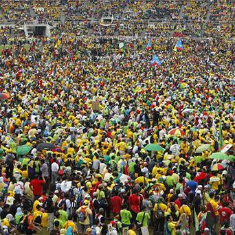 Malaysian protesters listen to their leader's speech during the People's Uprising Rally at Merdeka Stadium in Kuala Lumpur (AP)