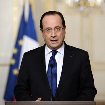 France's president Francois Hollande gives a speech focused on the Malian situation at the Elysee presidential palace in Paris (AP)