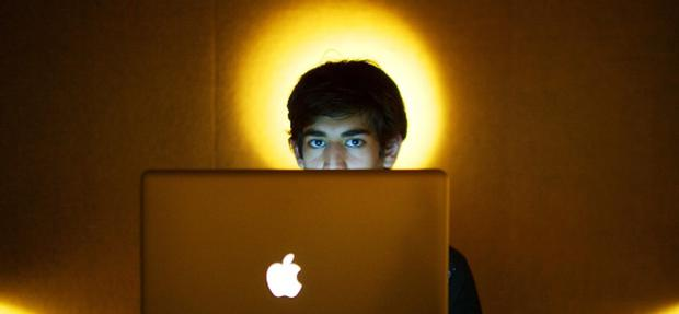 Internet activist Aaron Swartz poses for a photo in Miami Beach in 2009