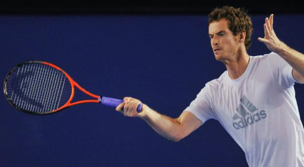 Andy Murray hits a return during a practice session at the Australian Open tennis tournament in Melbourne. Photo: Reuters