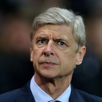 Arsene Wenger is determined to keep Theo Walcott at Arsenal