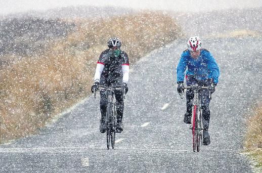 Despite the cold front, cyclists braved snow flurries in the Sally Gap, Co Wicklow
