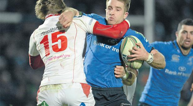 Leinster's Luke Fitzgerald is tackled by Liam Williams of Scarlets at the RDS