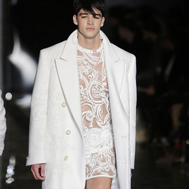 A model wears a creation of Versace's new winter collection, unveiled in Milan, Italy (AP)