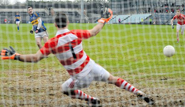 Tipperary's Barry Grogan scores his side's first goal from a penalty past Cork goalkeeper Ken O'Halloran