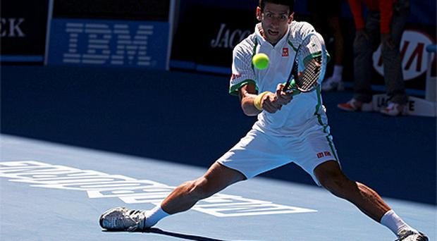 Novak Djokovic in action against Paul-Henri Mathieu