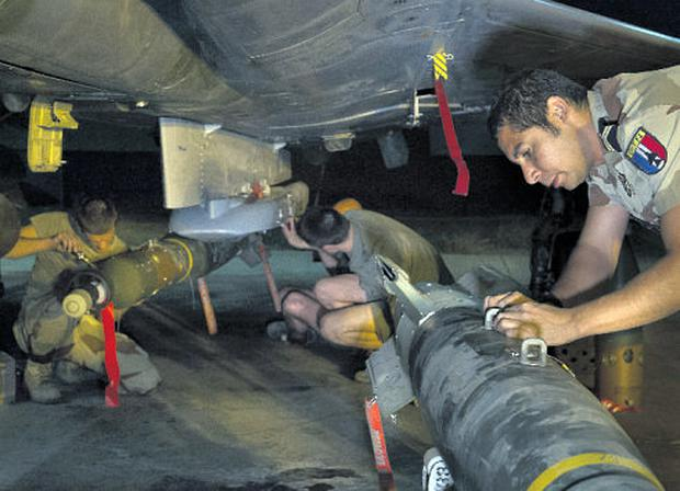French troops work on a fighter plane in Chad ahead of air strikes against Islamist rebels in Mali