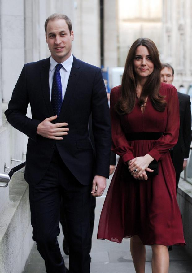 File photo dated 11/01/13 of The Duke and Duchess of Cambridge arriving at the National Portrait Gallery in London, as the couples baby is due in July, St JamesÕs Palace confirmed today. PRESS ASSOCIATION Photo. Issue date: Monday January 14, 2013. The DuchessÕs condition is continuing to improve following her earlier hospital stay for severe morning sickness, a spokesman said. See PA story ROYAL Baby. Photo credit should read: Stefan Rousseau/PA Wire