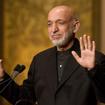 Afghanistan president Hamid Karzai wants a national conference over US troops (AP)