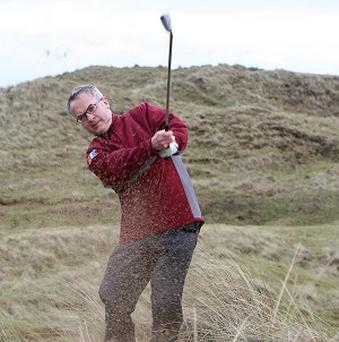 Alex Attwood plays golf on the site of the proposed Bushmills Dunes golf course