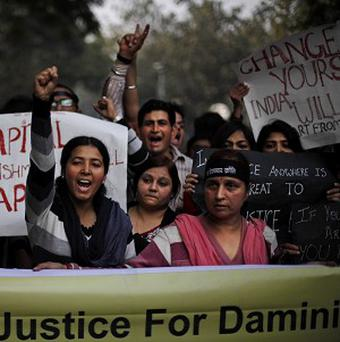 The name 'Damini' on the banner is a symbolic name given to a victim who was gang raped on a New Delhi bus in December (AP)