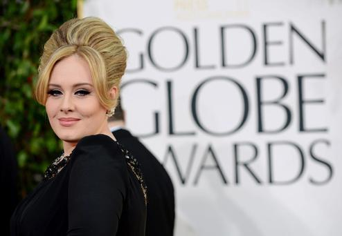 New mum Adele brought Robbie William's wife as her guest to the Globes.