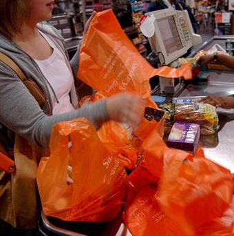 A plan to charge shoppers for using plastic bags has been approved by the Assembly