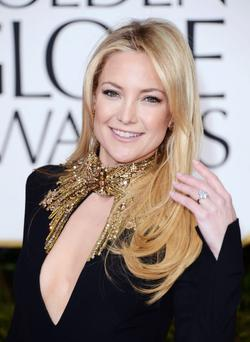 Hudson opted to wear a dazzling black Alexander McQueen gown with gold bead work