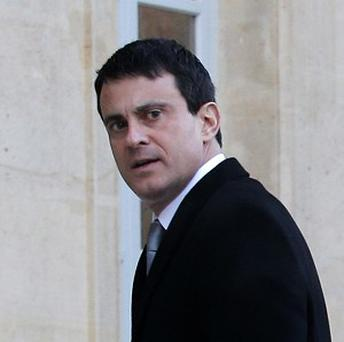 Manuel Valls said France was facing 'an exterior enemy and an interior enemy' (AP)