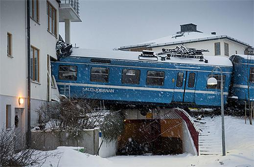 The scene where a stolen train crashed into the side of a residential building in Saltsjobaden outside Stockholm