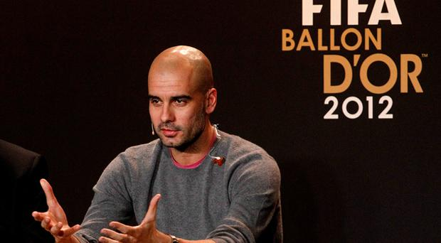 Pep Guardiola addresses a news conference before the FIFA Ballon d'Or 2012 Gala