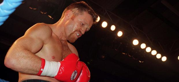 Steve Collins concentrates hard on the task ahead prior to his fight with Neville Brown in Millstreet, Co. Cork, Ireland. Boxing. 9/3/96. Picture credit; Brendan Moran/SPORTSFILE