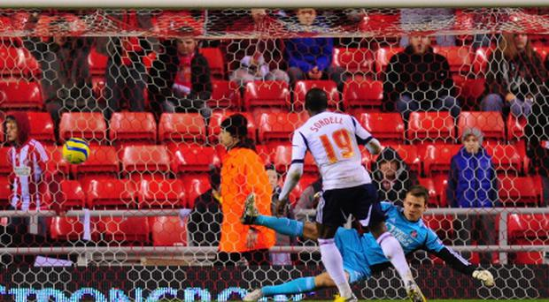 SUNDERLAND, ENGLAND - JANUARY 15: Bolton player Marvin Sordell scores from the penalty spot past Sunderland goalkeeper Simon Mignolet during the FA Cup Third Round Replay between Sunderland and Bolton Wanderers at Stadium of Light on January 15, 2013 in Sunderland, England. (Photo by Stu Forster/Getty Images)