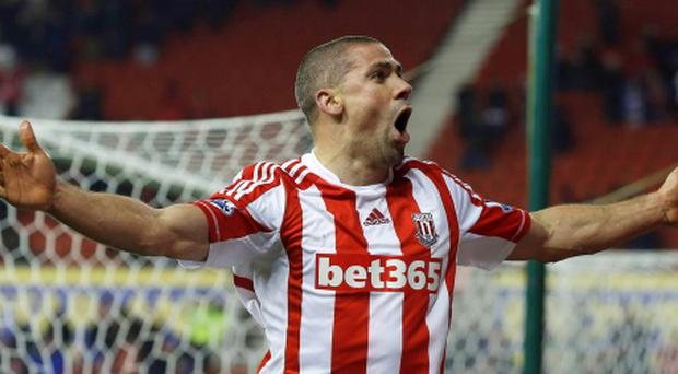 Stoke City's Jonathan Walters celebrates after scoring against Crystal Palace during their FA Cup third round replay soccer match at The Britannia Stadium in Stoke on Trent, central England January 15, 2013. REUTERS/Phil Noble (BRITAIN - Tags: SPORT SOCCER)