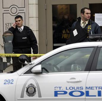 Police investigate outside the scene of a shooting in St Louis (AP/Jeff Roberson)