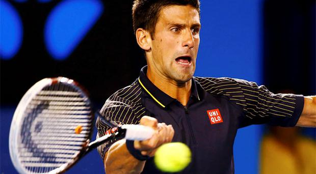 16 January, 2013: Novak Djokovic hits a return to Ryan Harrison of the US during their men's singles match at the Australian Open. Photo: Reuters