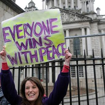 A peace protester at Belfast City Hall demonstrates in response to the continuing loyalist flag violence