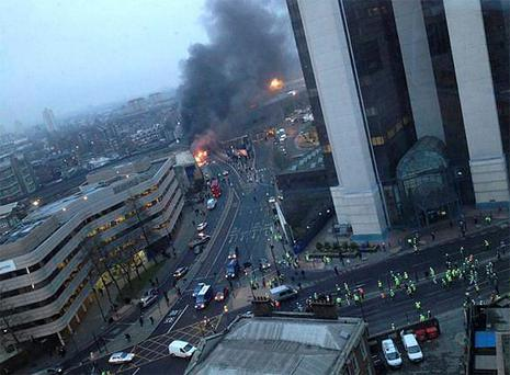 <b>Wednesday</b><br/> A general view of the scene where a helicopter crashed in central London, after hitting a crane on top of a tower block by the River Thames