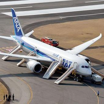 An All Nippon Airways Boeing 787 sits at Takamatsu airport in Takamatsu, western Japan after it made an emergency landing (AP/Kyodo News)