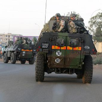 French troops in two armoured personnel carriers drive through Mali's capital Bamako on the road to Mopti (AP)