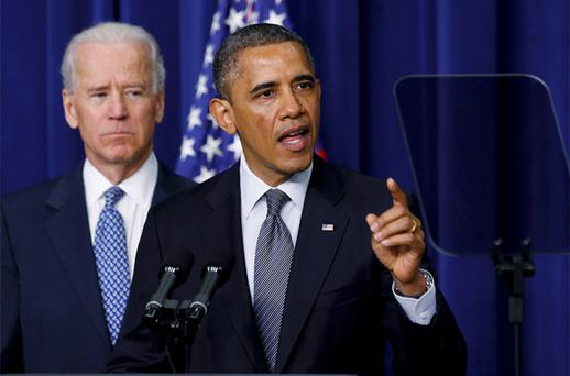 US President Barack Obama and Vice President Joe Biden announce a series of proposals to counter gun violence. Photo: Reuters