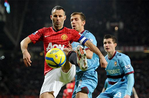 West Ham United's Gary O'Neil (right) and Manchester United's Ryan Giggs (left) battle for the ball during the FA Cup Third Round Replay at Old Trafford. Photo: PA